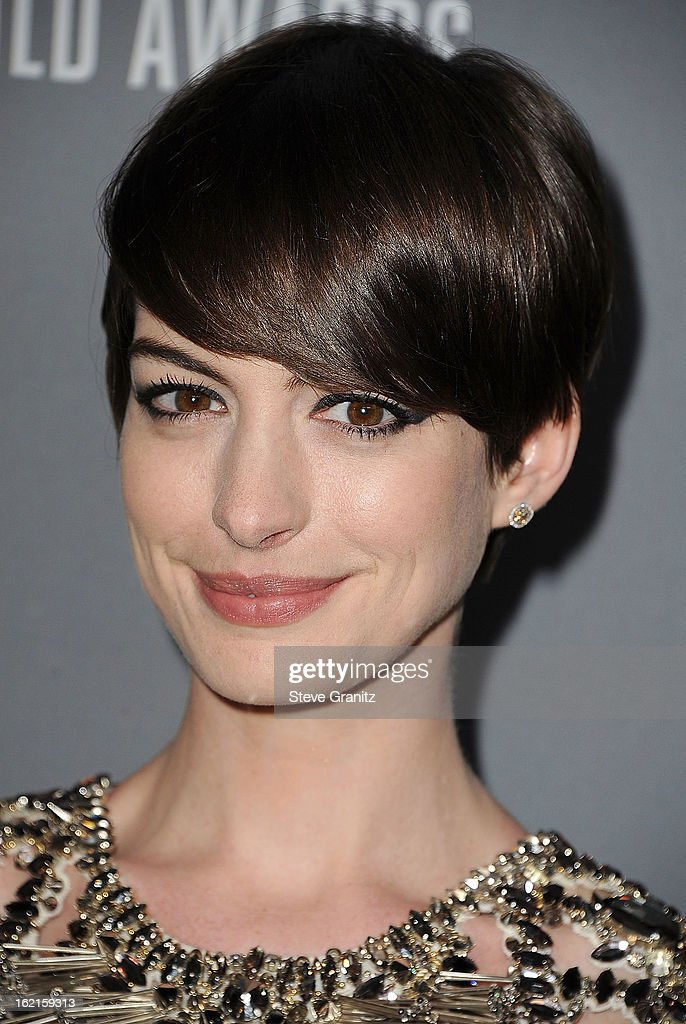 Anne Hathaway arrive at the 15th Annual Costume Designers Guild Awards at The Beverly Hilton Hotel on February 19, 2013 in Beverly Hills, California.