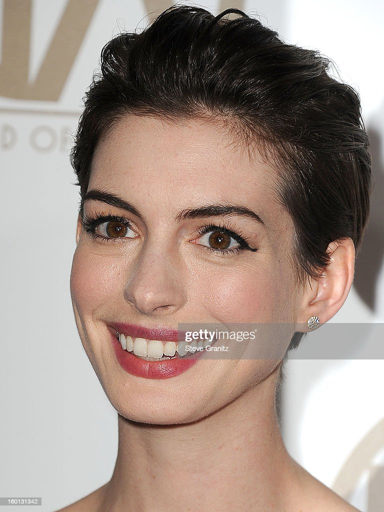Anne Hathaway arrive at the 24th Annual Producers Guild Awards at The Beverly Hilton Hotel on January 26, 2013 in Beverly Hills, California.