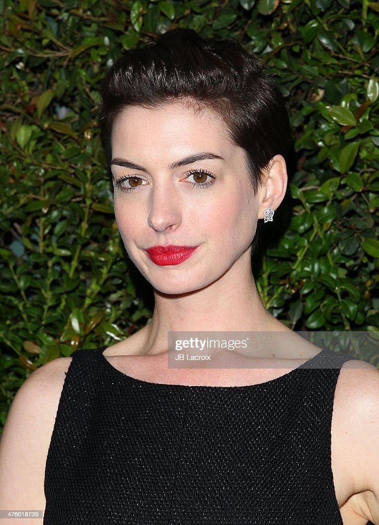 Anne Hathaway attends the Chanel Charles Finch Pre-Oscar Dinner held at Madeo Restaurant on March 1, 2014 in Los Angeles, California.
