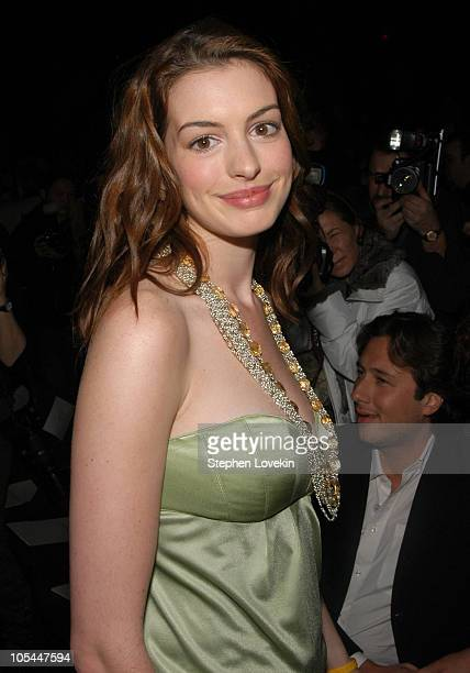 Anne Hathaway during Olympus Fashion Week Fall 2005 Luca Luca Front Row and Backstage at Bryant Park Tents in New York City New York United States