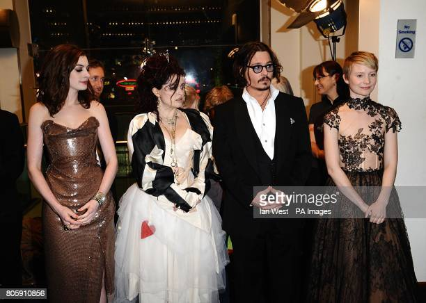 Anne Hathaway Helena Bonham Carter Johnny Depp and Mia Wasikowska wait to meet the The Prince of Wales and The Duchess of Cornwall during the Royal...