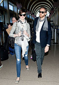 Anne Hathaway is seen at Los Angeles International Airport with her husband Adam Shulman on March 13 2013 in Los Angeles California