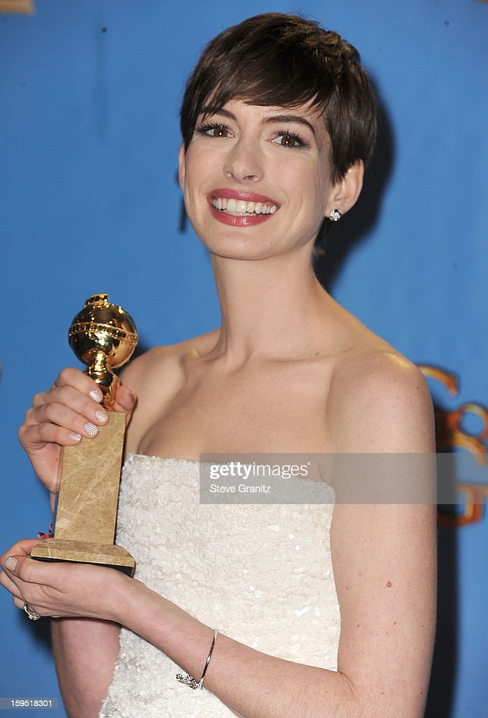 Anne Hathaway poses at the 70th Annual Golden Globe Awards at The Beverly Hilton Hotel on January 13, 2013 in Beverly Hills, California.