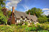 Anne Hathaway's Cottage, the farmhouse where the wife of William Shakespeare lived as a child, is in the village of Shottery, Warwickshire, England, about 1 mile west of Stratford-upon-Avon.