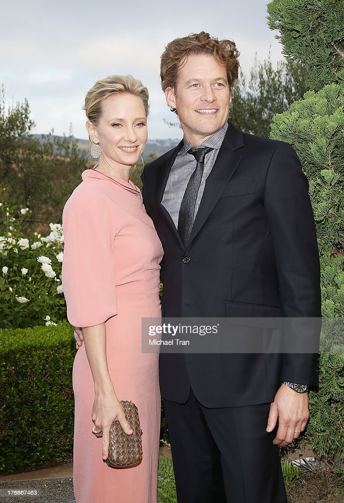 <a gi-track='captionPersonalityLinkClicked' href=/galleries/search?phrase=Anne+Heche&family=editorial&specificpeople=202988 ng-click='$event.stopPropagation()'>Anne Heche</a> (L) and <a gi-track='captionPersonalityLinkClicked' href=/galleries/search?phrase=James+Tupper&family=editorial&specificpeople=619618 ng-click='$event.stopPropagation()'>James Tupper</a> arrive at the 6th Annual Oceana's Annual SeaChange Summer Party held at a private residence on August 18, 2013 in Laguna Beach, California.