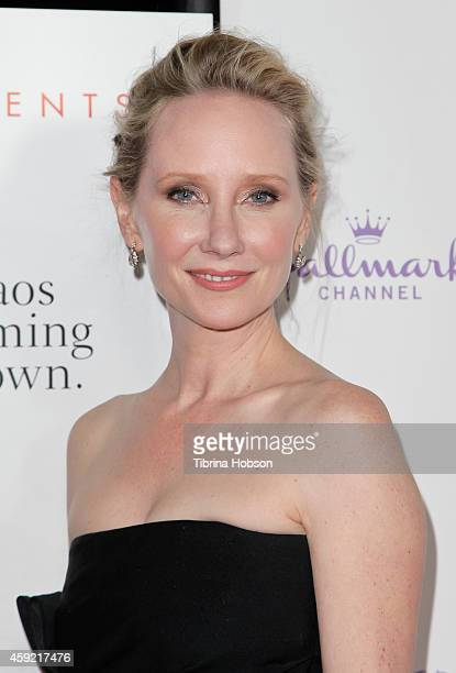 Anne Heche attends the Hallmark Hall of Fame 'One Christmas Eve' Los Angeles premiere at Fig Olive Melrose Place on November 18 2014 in West...