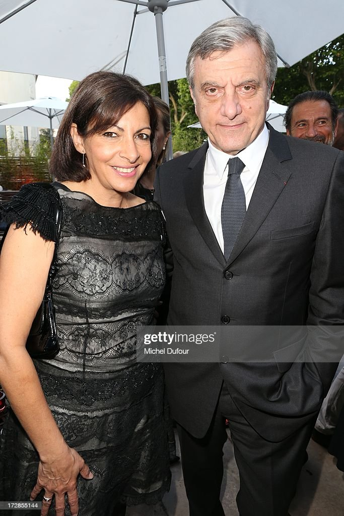 Anne Hidalgo and <a gi-track='captionPersonalityLinkClicked' href=/galleries/search?phrase=Sidney+Toledano&family=editorial&specificpeople=758670 ng-click='$event.stopPropagation()'>Sidney Toledano</a> (R) attend the'Chambre Syndicale de la Haute Couture' Cocktail attends Chambre Syndicale de la Haute Couture cocktail party at Palais De Tokyo on July 4, 2013 in Paris, France.