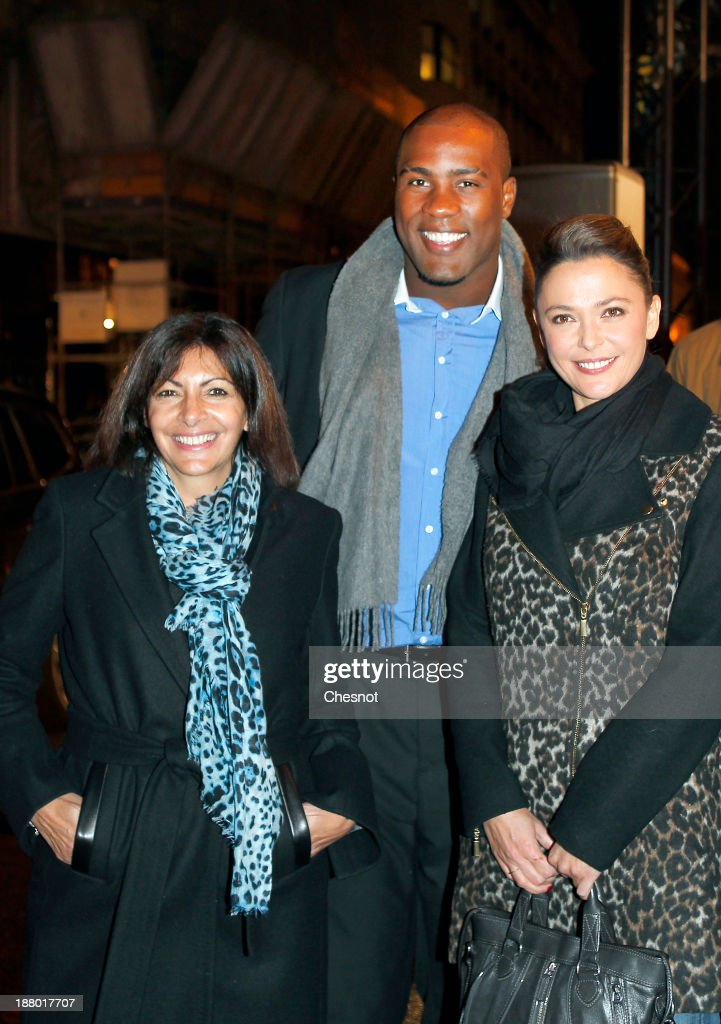 Anne Hidalgo (L), French Judoka Teddy Riner (C) and television host, Sandrine Quetier attend a Christmas Lights at Faubourg Saint-Honore on November 14, 2013 in Paris, France. Every year the committee of the Faubourg Saint-Honore Royal organizes the Faubourg St Honore illumination.