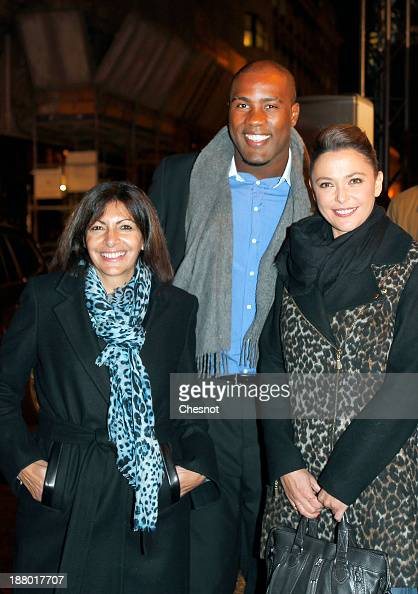 Anne Hidalgo French Judoka Teddy Riner and television host Sandrine Quetier attend a Christmas Lights at Faubourg SaintHonore on November 14 2013 in...