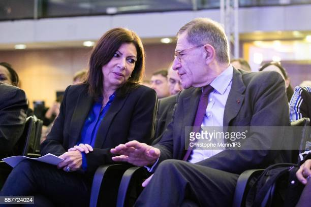 Anne Hidalgo Mayor City of Paris speaks with Gerard Mestrallet Chairman of the Board ENGIE and CoChair Board of Governors Conference of Paris as they...