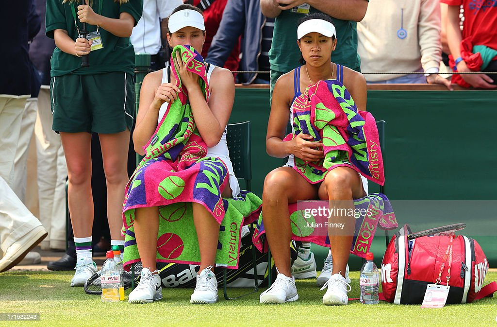 Anne Keothavong and Johanna Konta of Great Britain look on during a break in their Ladies' Doubles first round match against Sara Errani of Italy and Roberta Vinci of Italy on day three of the Wimbledon Lawn Tennis Championships at the All England Lawn Tennis and Croquet Club on June 26, 2013 in London, England.