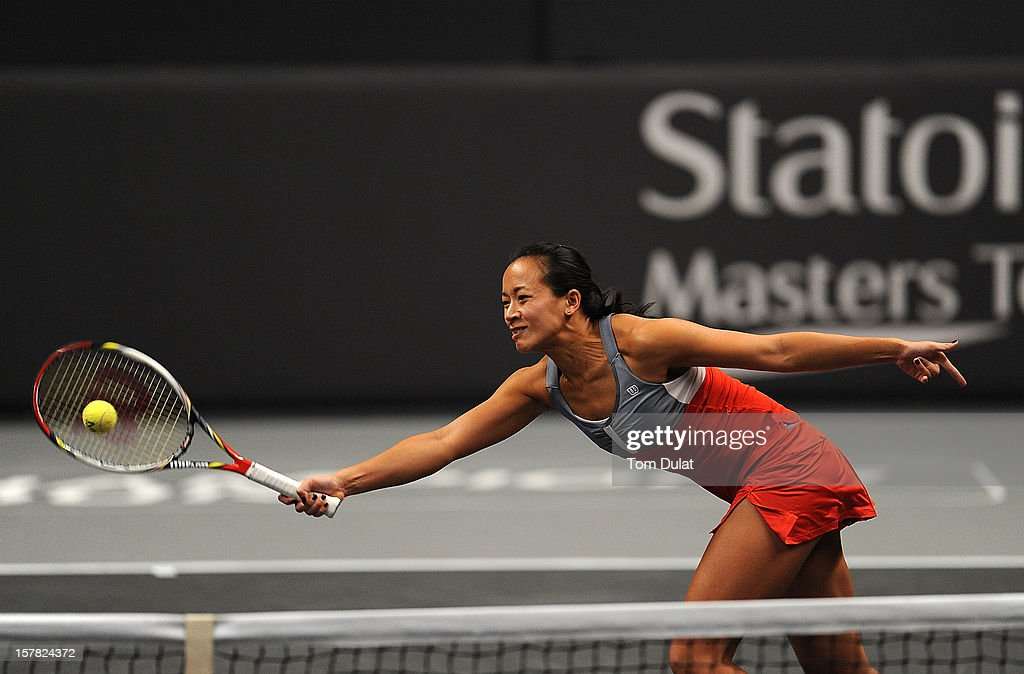 <a gi-track='captionPersonalityLinkClicked' href=/galleries/search?phrase=Anne+Keothavong&family=editorial&specificpeople=226838 ng-click='$event.stopPropagation()'>Anne Keothavong</a> of Great Britain in action during match against Heather Watson and Tim Henman of Great Britain on Day Two of the Statoil Masters Tennis at the Royal Albert Hall on December 6, 2012 in London, England.