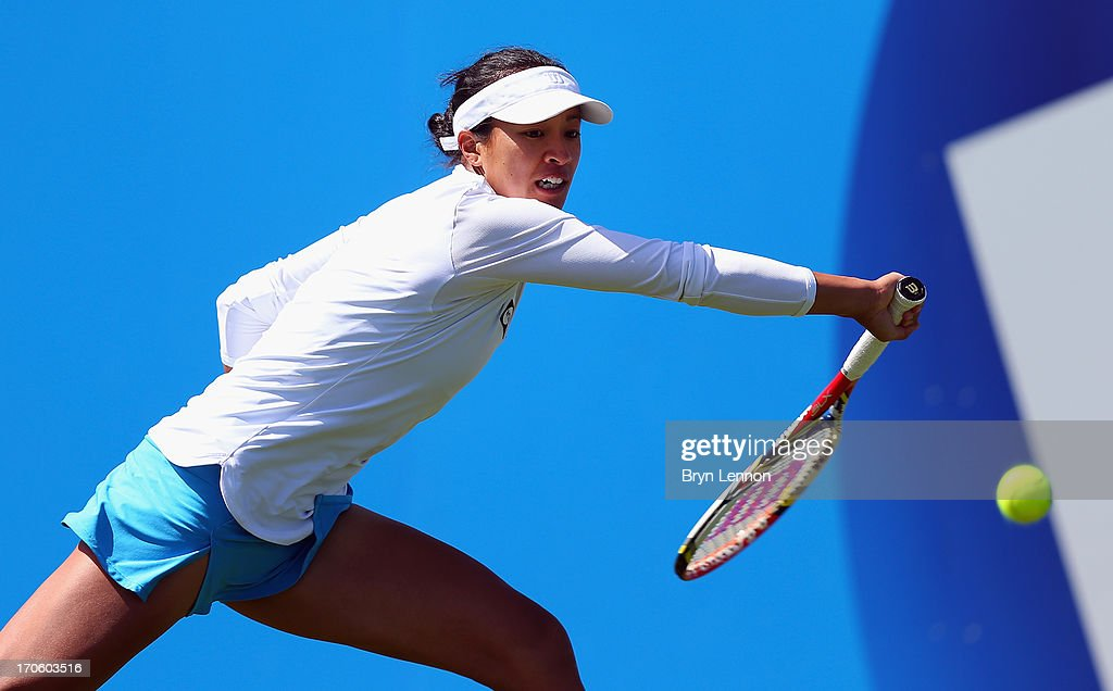 <a gi-track='captionPersonalityLinkClicked' href=/galleries/search?phrase=Anne+Keothavong&family=editorial&specificpeople=226838 ng-click='$event.stopPropagation()'>Anne Keothavong</a> of Great Britain in action in her qualifying match against Tara Moore during day one of the Aegon Interantional at Devonshire Park on June 15, 2013 in Eastbourne, England.