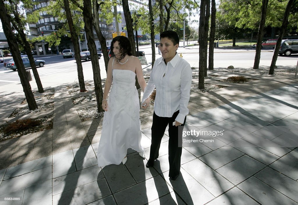 Anne Latl and Rosa DeJesus smile and hold hands after being granted a civil union at Stamford town hall October 1 2005 in Stamford Connecticut...