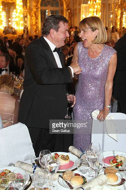 Anne Lauvergeon CEO of Areva and former German Chancellor Gerhard Schroeder attend the Mariinsky Ball of Montblanc White Nights Festival at Catherine...