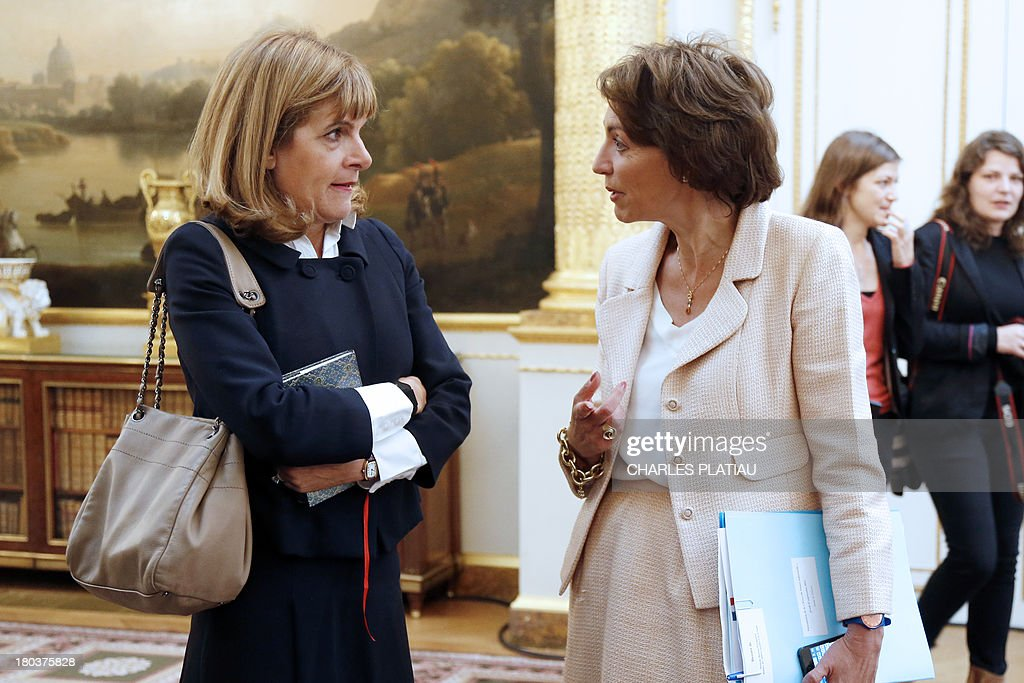 Anne Lauvergeon (L), head of the commission 'Innovation 2030', talks to French Minister of Social Affairs and Health Marisol Touraine as they visit an exhibition on French industrial design and technology at the Elysee Palace on September 12, 2013 in Paris.