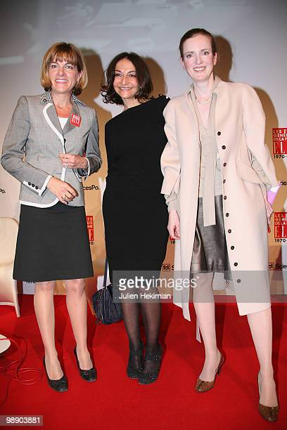 Anne Lauvergeon Nathalie Rykiel and Nathalie KosciuskoMorizet pose on the last day of the Women's Forum at French Political Sciences Institute in...