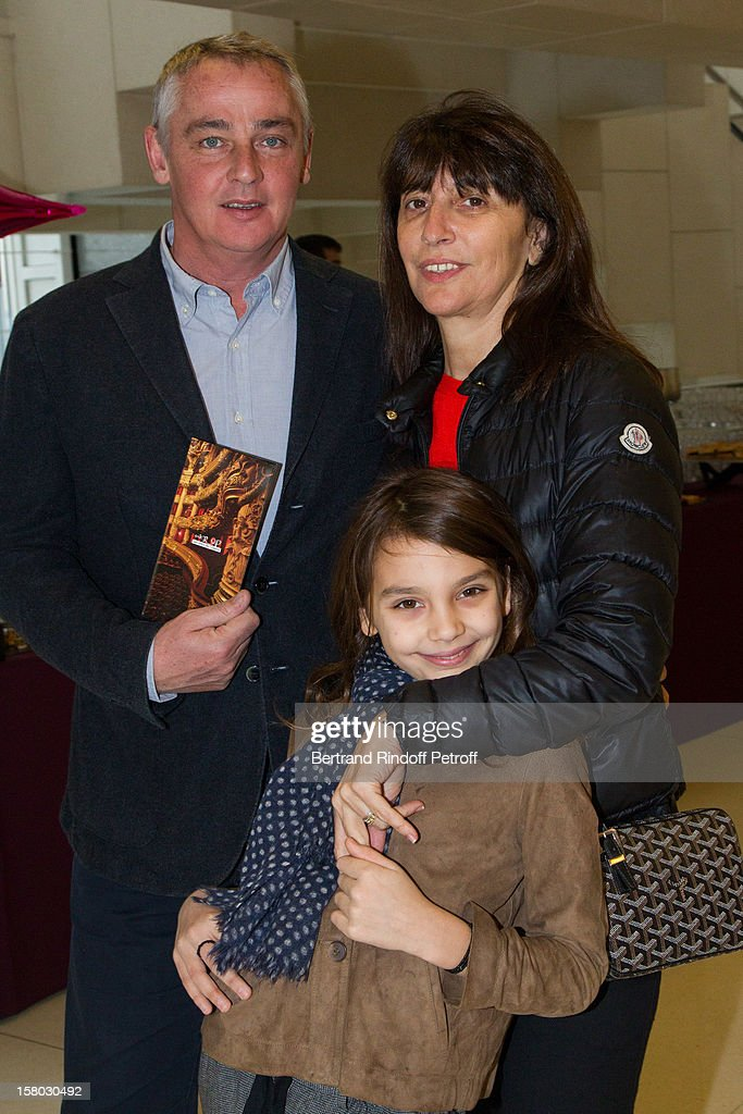 Anne Marcassus and daughter Giulia and husband Fabrice Le Ruyet pose before the Don Quichotte Ballet Hosted By 'Reve d'Enfants' Association and AROP at Opera Bastille on December 9, 2012 in Paris, France.