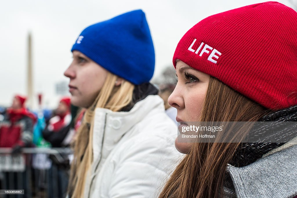Anne Marie Holter (L) of Gilbert, Arizona, and Jessica Ingstrum of Chandler, Arizona attend the March for Life on January 25, 2013 in Washington, DC. The pro-life gathering is held each year around the anniversary of the Roe v. Wade Supreme Court decision.
