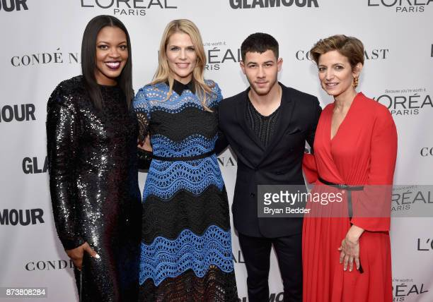 Anne Marie NelsonBogle Alison Moore Nick Jonas and Cindi Leive attend Glamour's 2017 Women of The Year Awards at Kings Theatre on November 13 2017 in...