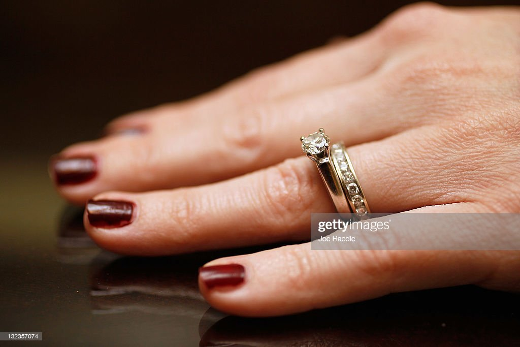 Anne McGuinn wears her 15carat diamond engagement ring on November 11 2011 in Margate Florida Her husband Brian McGuinn says that after realizing he...