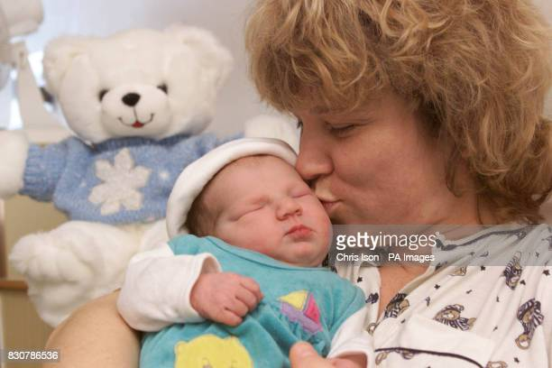 Anne Meier gently kisses her daughter Rhea born at 1230 am this morning New Year's Day at St Mary's Hospital in Portsmouth Hampshire Security staff...