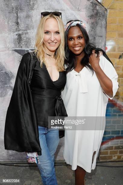 Anne MeyerMinnemann and Motsi Mabuse attend the Riani Fashion Show Spring/Summer 2018 at Umspannwerk Kreuzberg on July 4 2017 in Berlin Germany