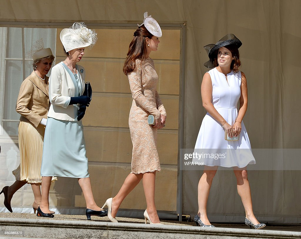 Anne, Princess Royal, Catherine, Duchess of Cambridge and Princess Eugenie of York talk during a garden party held at Buckingham Palace on June 10, 2014 in London, England.
