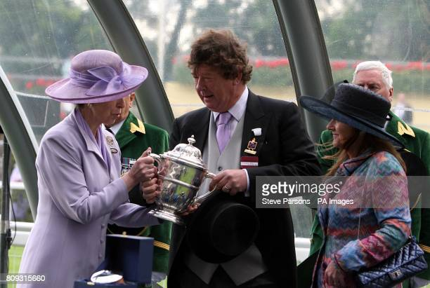 Anne Princess Royal presents owner Michael KerrDineen with a trophy after Pisco Sour wins the Tercentenary Stakes during Day Three of the 2011 Royal...