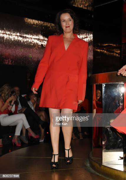 Anne Roumanoff by Max Azria walks the runway during the 'Red Defile' Auction Fashion Show Hosted by Ajila Association Association Against Women Heart...