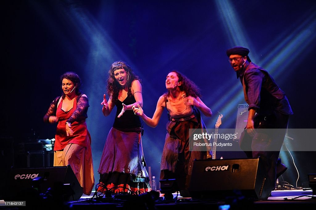 Anne Roy, Beatriz Salmeron-Martin, Lilia Ruocco, and Fouad Achkir (L-R) of Chet Nuneta (France) singing featuring a dazzling sound and theatrical display of vocal polyphonies and polyrhythms. They sing transcontinental traditional songs accompanied by mostly percussion in Rainforest World Music Festival at Sarawak Cultural Village on June 28, 2013 in Kuching, Sarawak, Malaysia.