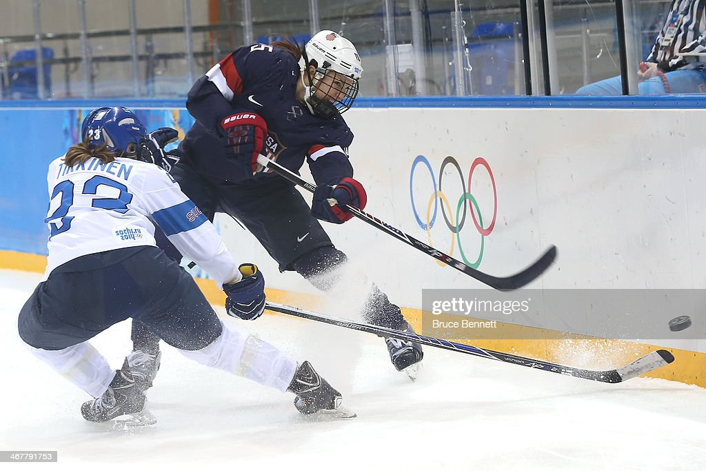 <a gi-track='captionPersonalityLinkClicked' href=/galleries/search?phrase=Anne+Schleper&family=editorial&specificpeople=9030350 ng-click='$event.stopPropagation()'>Anne Schleper</a> #15 of United States passes the puck against Finland during the Women's Ice Hockey Preliminary Round Group A Game on day 1 of the Sochi 2014 Winter Olympics at Shayba Arena on February 8, 2014 in Sochi, Russia.