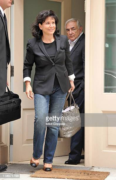 Anne Sinclair and former director of the International Monetary Fund Dominique StraussKahn leave their apartment on July 13 2011 in New York United...