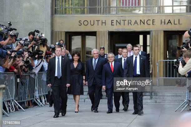 Anne Sinclair Dominique StraussKahn and lawyer Benjamin Brafman leave Manhattan Criminal Court after attending a status hearing on the sexual assault...