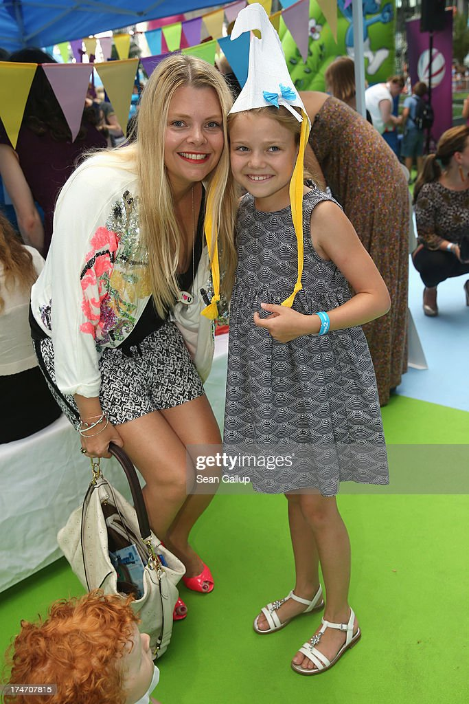 Anne- Sophie Briest and daughter Faye attend the 'Die Schluempfe 2' Germany Premiere at Sony Centre on July 28, 2013 in Berlin, Germany.