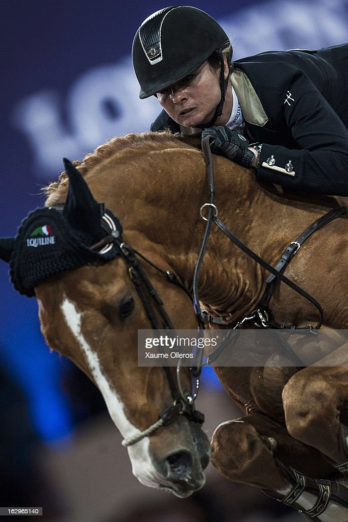 Anne Sophie Godart of France rides Carlito van 't Zorggvliet at the Longines Grand Prix during the Longines Hong Kong Masters International Show Jumping at Asia World Expo on March 2, 2013 in Hong Kong, Hong Kong.