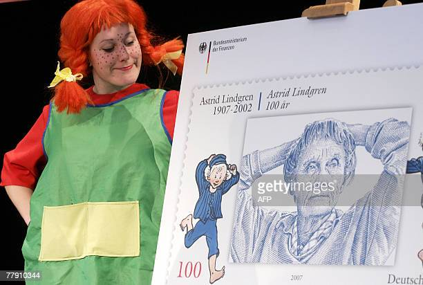 Anne Talhofer dressed as Pippi Longstocking presents a special stamp displaying Swedish author Astrid Lindgren 13 November 2007 in Berlin The stamp...