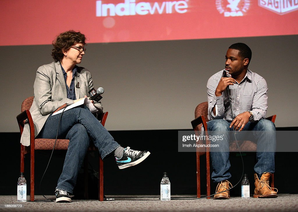 Anne Thompson of Thompson on Hollywood listens to 'Fruitvale Station' writer/director Ryan Coogler onstage during the Film Independent Forum at the DGA Theater on October 27, 2013 in Los Angeles, California.