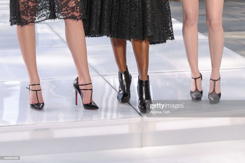 Anne V (Anne Vyalitsyna), Naomi Campbell and Lydia Hearst (shoe and boot detail) take part in the 'The Face' Season 2 Pop Up Fashion Show at Bryant Park on September 11, 2013 in New York City.