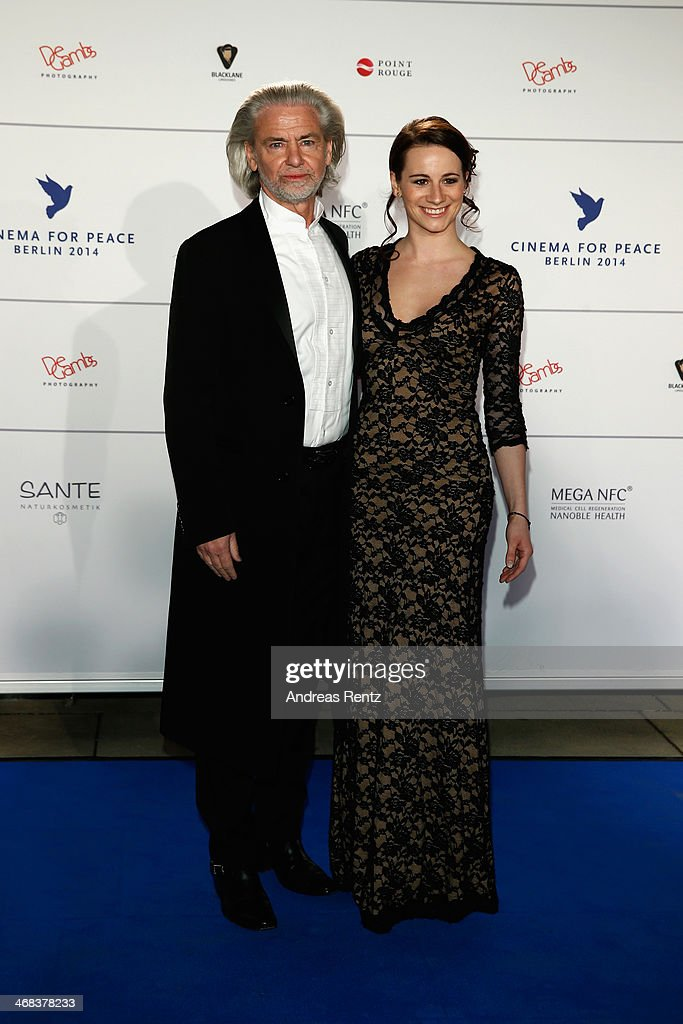 Anne Weiss and Hermann Buehlbecker arrive for the Cinema For Peace 2014 - Gala at Konzerthaus Am Gendarmenmarkt on February 10, 2014 in Berlin, Germany.