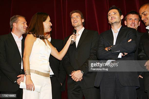 Anne Will and goalkeeper Jens Lehmann with Oliver Neuville At The Premiere Of The Film Of Cinema S Wortmann 'Germany A Summer Fairytale' on 031006