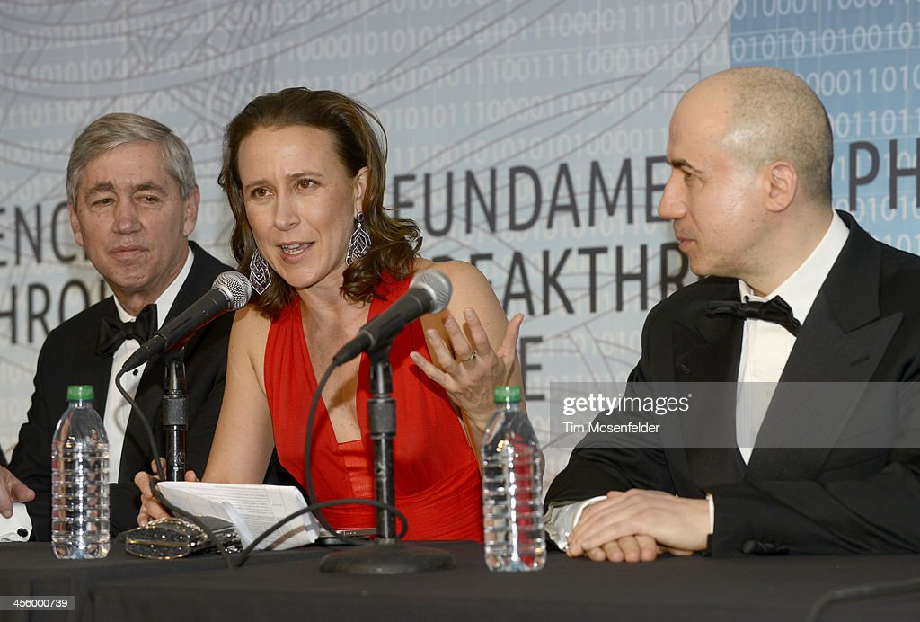 Anne Wojcick (C) and Yuri Milner host the press conference with the Breakthrough Prize Inaugural Ceremony Winners at Nasa Ames Research Center on December 12, 2013 in Mountain View, California.