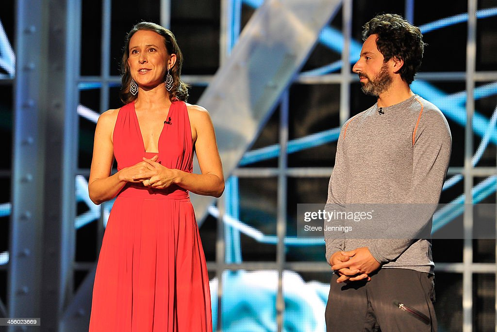 Anne Wojcicki and Sergey Brin (L-R) are presenters at the 2014 Breakthrough Prizes Awarded in Fundamental Physics and Life Sciences Ceremony at NASA Ames Research Center on December 12, 2013 in Mountain View, California.