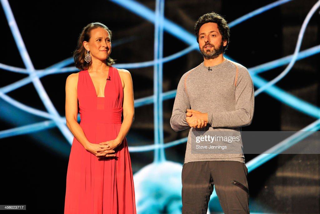 Anne Wojcicki and <a gi-track='captionPersonalityLinkClicked' href=/galleries/search?phrase=Sergey+Brin&family=editorial&specificpeople=753551 ng-click='$event.stopPropagation()'>Sergey Brin</a> (L-R) are presenters at the 2014 Breakthrough Prizes Awarded in Fundamental Physics and Life Sciences Ceremony at NASA Ames Research Center on December 12, 2013 in Mountain View, California.