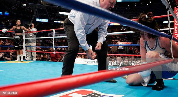 Anne Wolfe waits in the corner after knocking down Marsha Valley during the IBA Light Heavyweight Womens's Championship Bout on June 18 2005 at the...