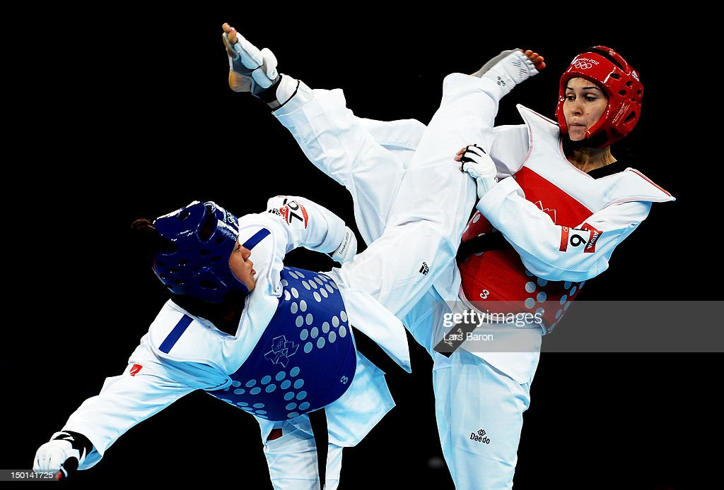 AnneCaroline Graffe of France competes against Natalya Mamatova of Uzbekistan during the Women's 67kg Taekwondo Preliminary Roundon on Day 15 of the...
