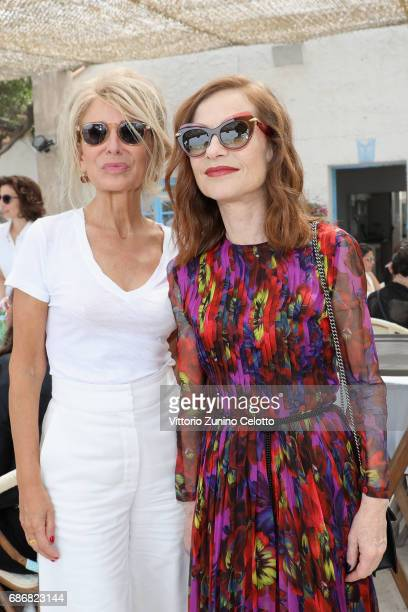 AnneFlorence Schmitt and Isabelle Huppert attend Kering Women in motion lunch with Madame Figaro on May 22 2017 in Cannes France