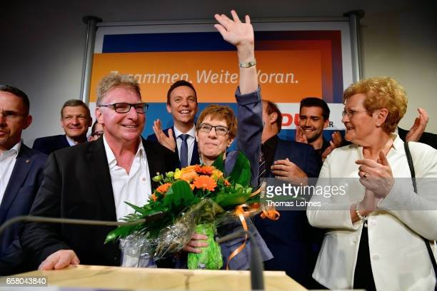 Annegret KrampKarrenbauer lead candidate of the German Christian Democrats and her husband Hemut Karrenbauer celebrate at the CDU elections party...