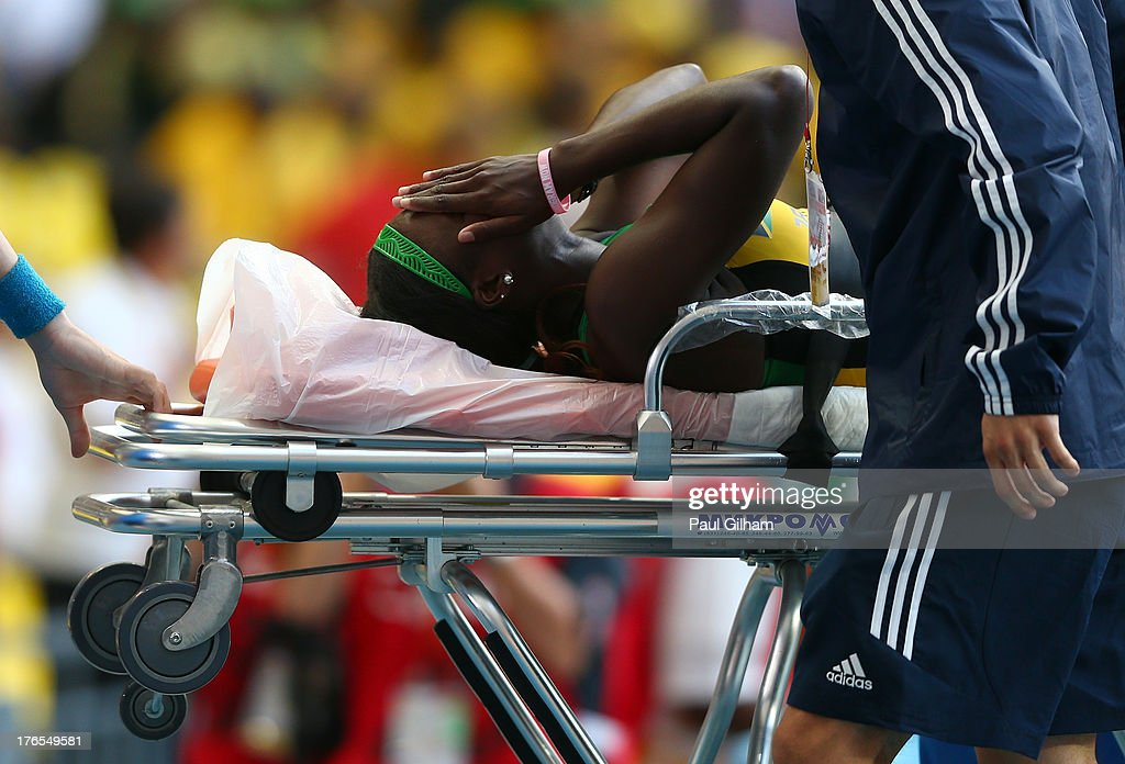 Anneisha McLaughlin of Jamaica receives treatment in the Women's 200 metres semi finals during Day Six of the 14th IAAF World Athletics Championships Moscow 2013 at Luzhniki Stadium on August 15, 2013 in Moscow, Russia.