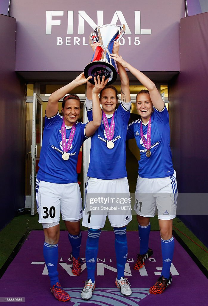 Anne-Kathrine Kremer, Desiree Schumann and Anke Preuss of Frankfurt celebrate with the cup after winning the UEFA Women's Champions League final match between 1. FFC Frankfurt and Paris St. Germain at Friedrich-Ludwig-Jahn Sportpark on May 14, 2015 in Berlin, Germany.